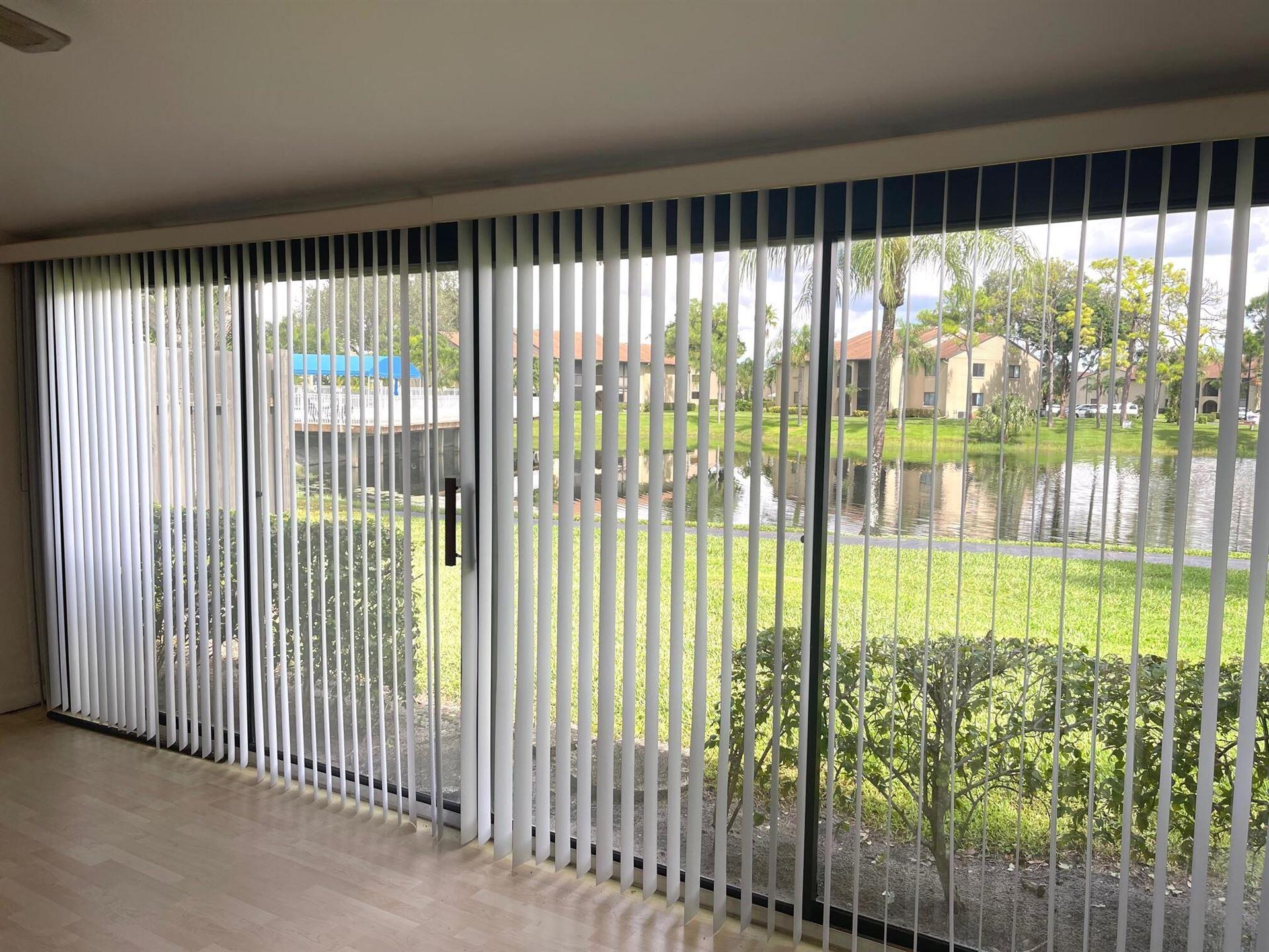 Photo of 541 Shady Pine Way #H, Greenacres, FL 33415 (MLS # RX-10747934)