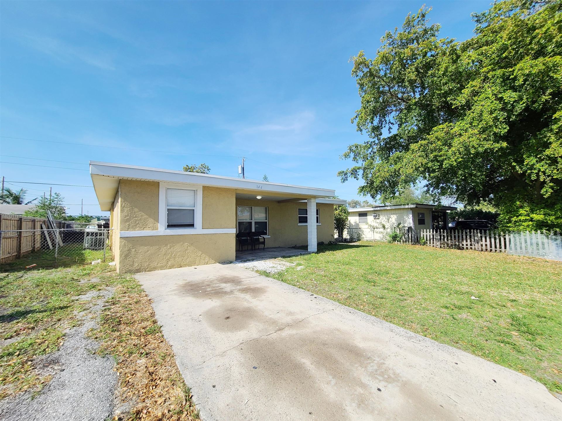 Photo of 146 W 17th Street, Riviera Beach, FL 33404 (MLS # RX-10713935)