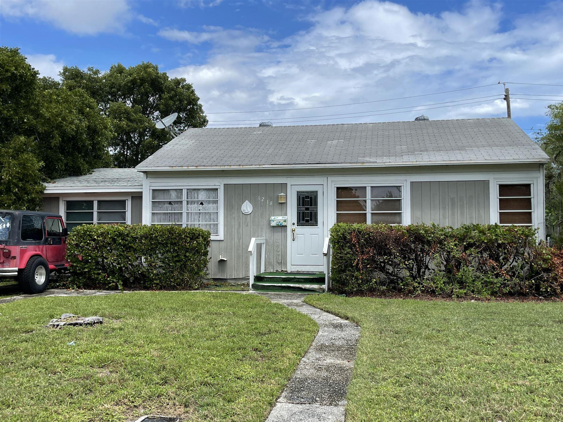 Photo of 1218 13th Avenue N, Lake Worth Beach, FL 33460 (MLS # RX-10747936)