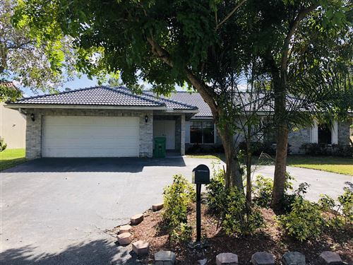 Photo of 9800 NW 47th Drive, Coral Springs, FL 33076 (MLS # RX-10592939)
