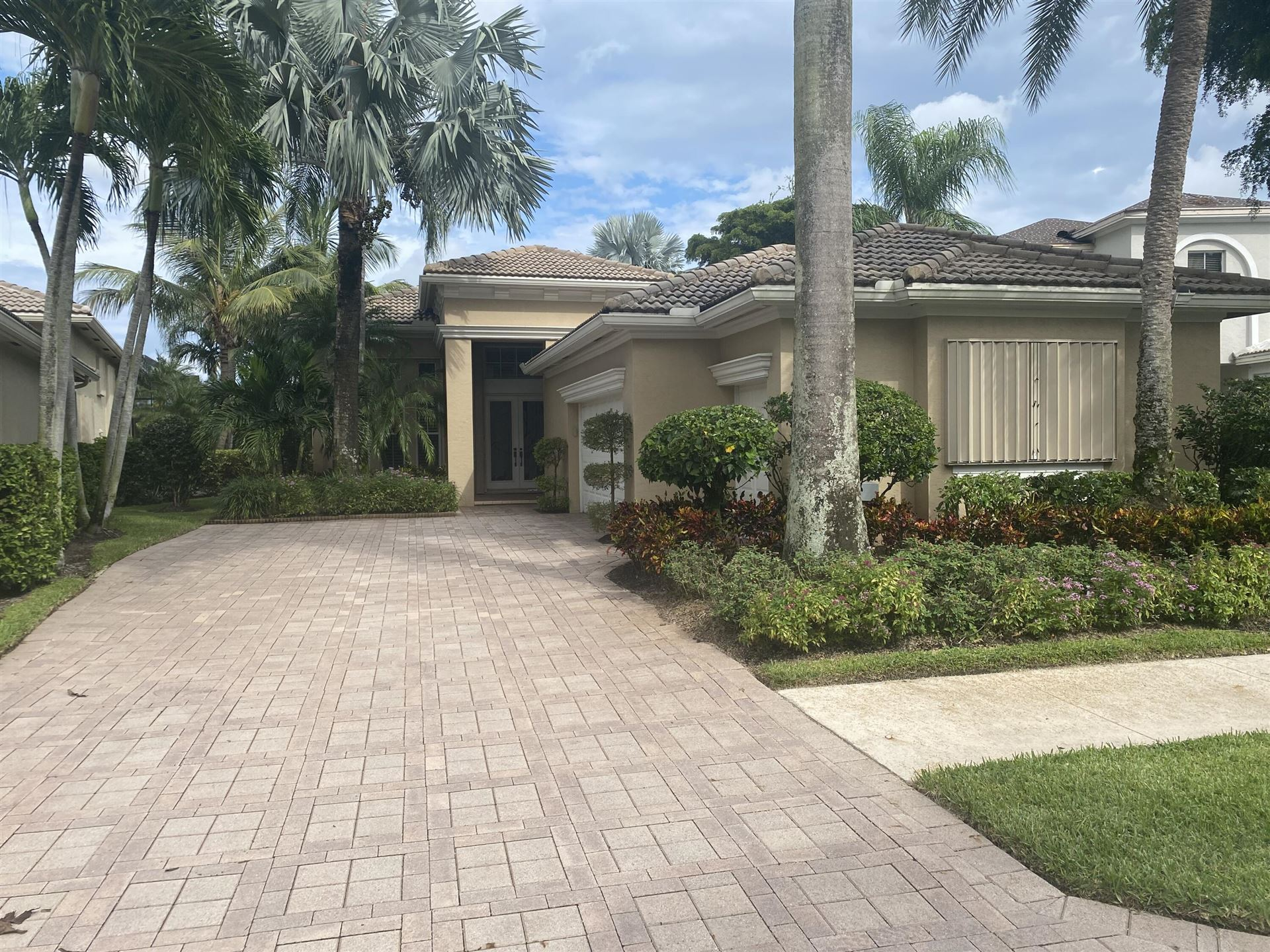 Photo of 163 Orchid Cay Drive, Palm Beach Gardens, FL 33418 (MLS # RX-10747939)