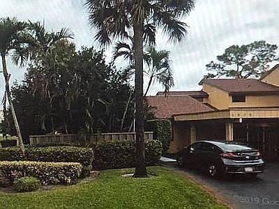 Photo of 2393 Woodlands Way, Deerfield Beach, FL 33442 (MLS # RX-10683941)