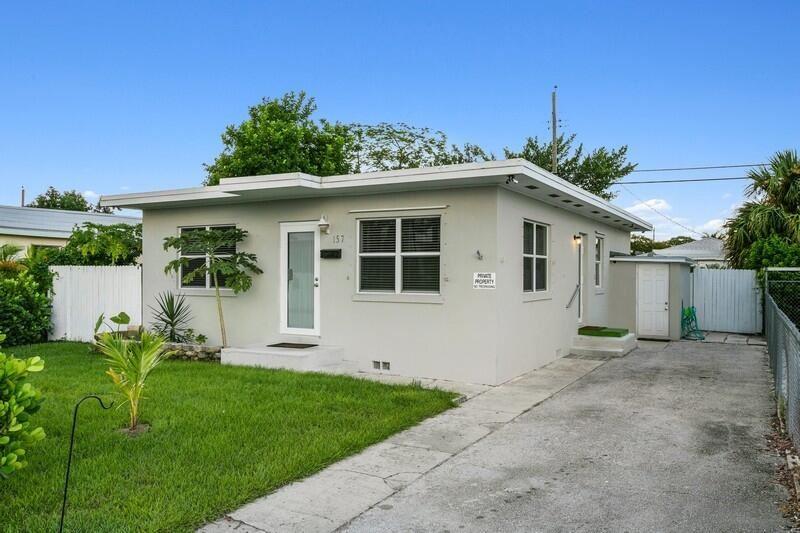 Photo of 157 E 25th Street, Riviera Beach, FL 33404 (MLS # RX-10750941)