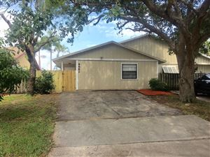 Photo of 8682 Crater Terrace, Lake Park, FL 33403 (MLS # RX-10530948)