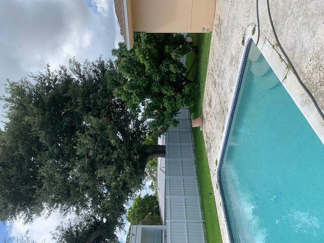 Photo of 1850 NE 199th Street, Miami, FL 33179 (MLS # RX-10747949)