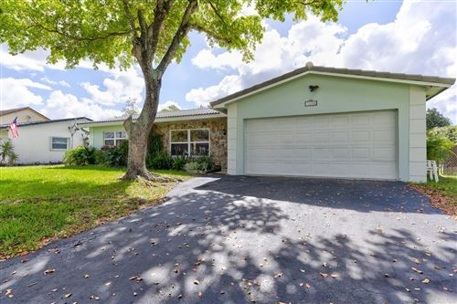 Photo of 11040 NW 43rd Court, Coral Springs, FL 33065 (MLS # RX-10574951)
