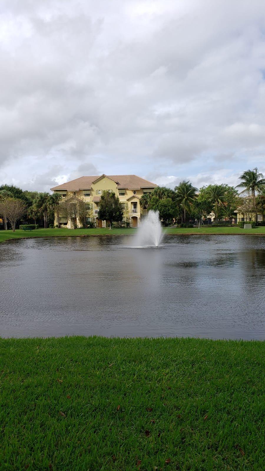 Photo of 3919 Passion Flower Road, Coconut Creek, FL 33073 (MLS # RX-10670955)