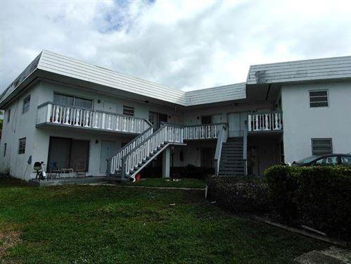 Photo of 519 Kalmia Drive, Lake Park, FL 33403 (MLS # RX-10465956)