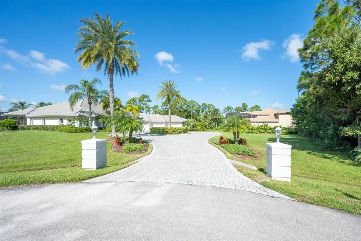 Photo of 7842 Sabal Lake Drive, Port Saint Lucie, FL 34986 (MLS # RX-10663960)