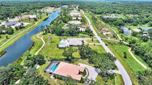Photo of 10096 Calabrese Trail #10, Jupiter, FL 33478 (MLS # RX-10667963)