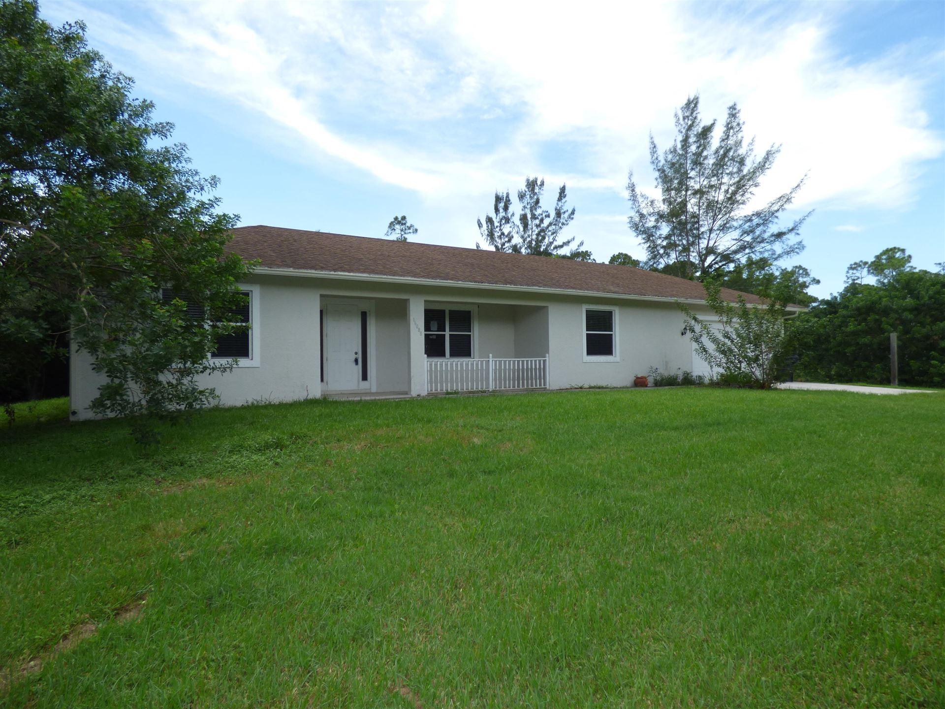 Photo of 16088 E Downers Drive E, Loxahatchee, FL 33470 (MLS # RX-10646964)