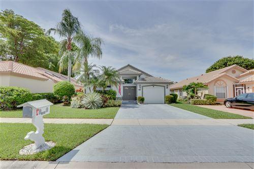 Photo of 6050 Bluegrass Drive, Boynton Beach, FL 33437 (MLS # RX-10624967)