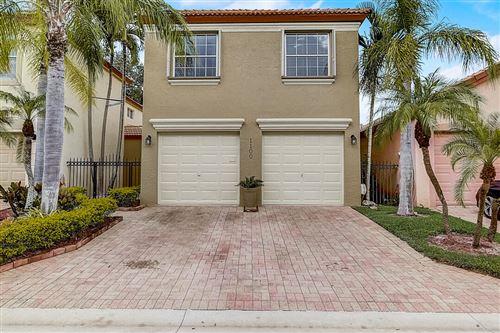 Photo of 1100 Via Jardin, Riviera Beach, FL 33418 (MLS # RX-10752969)