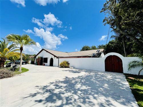 Photo of 457 S Naranja Avenue, Port Saint Lucie, FL 34983 (MLS # RX-10731970)