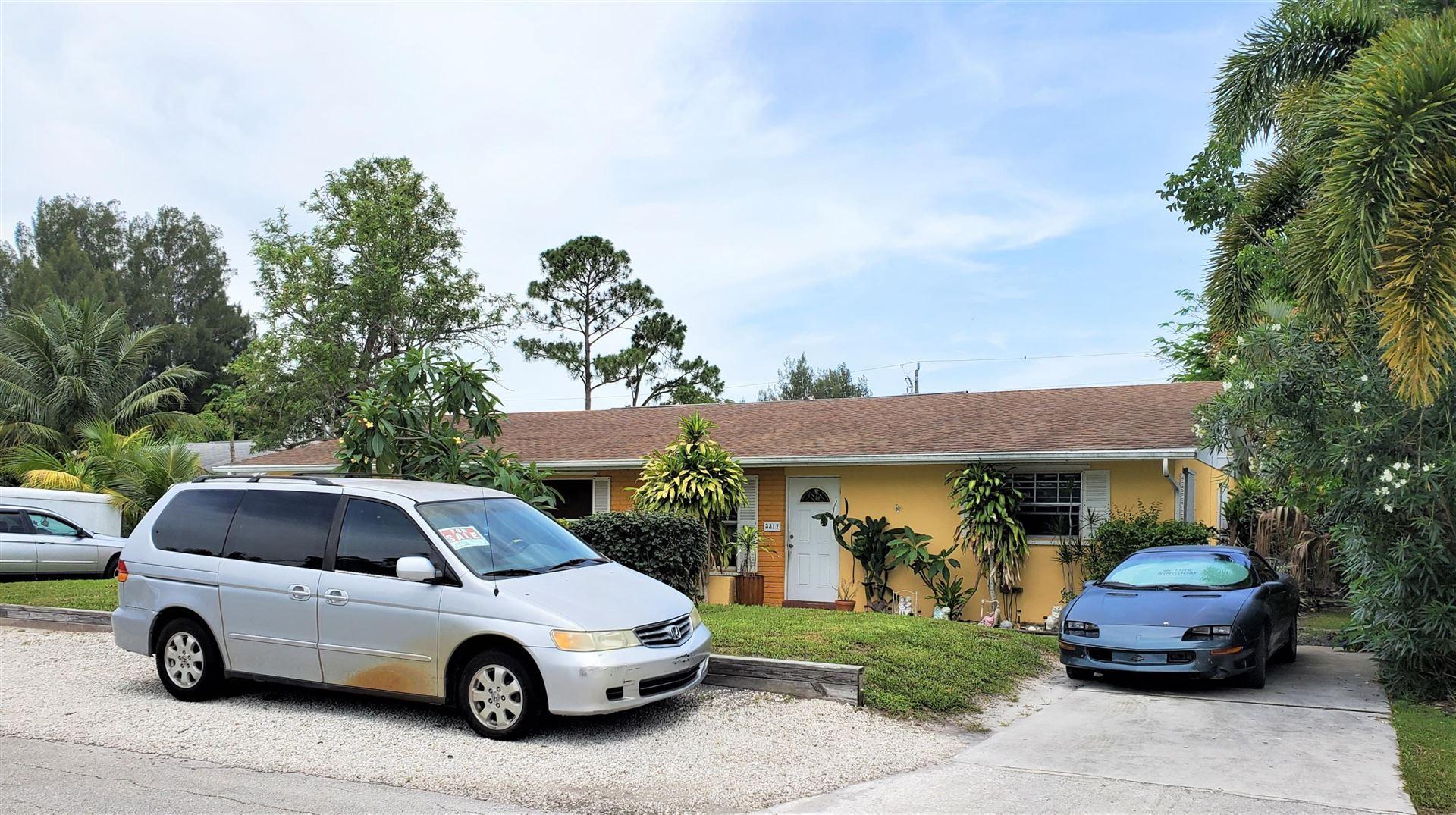 Photo of 3307 SE Iris Street, Stuart, FL 34997 (MLS # RX-10626971)