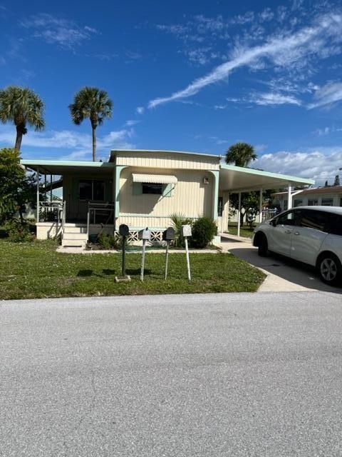 Photo of 2420 SE Penny Lane, Stuart, FL 34994 (MLS # RX-10753973)