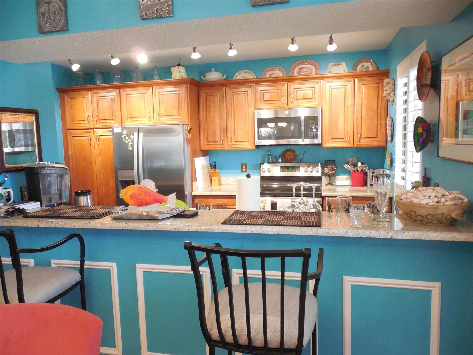 Photo of 511 Brackenwood Place, Palm Beach Gardens, FL 33418 (MLS # RX-10680974)