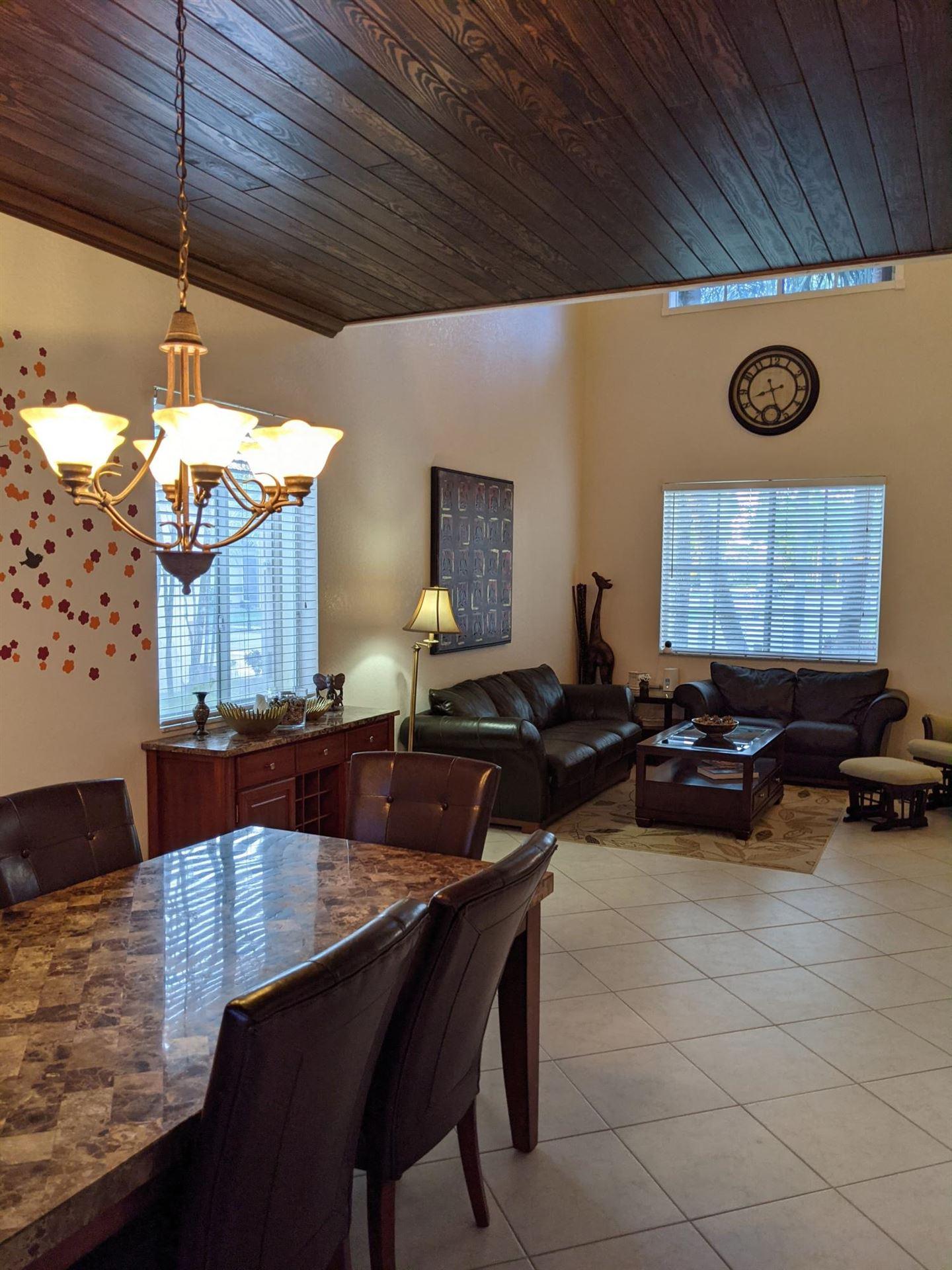 Photo of 5032 Mallards Place, Coconut Creek, FL 33073 (MLS # RX-10731975)