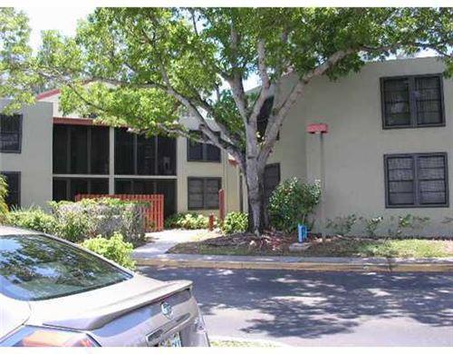 Photo of 211 Lake Pointe Drive #202, Oakland Park, FL 33309 (MLS # RX-10753977)