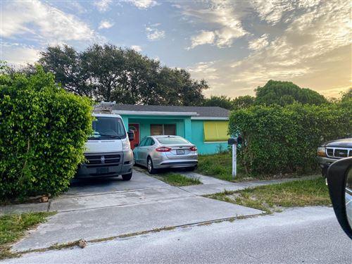 Photo of 142 W 34th Street, Riviera Beach, FL 33404 (MLS # RX-10637983)