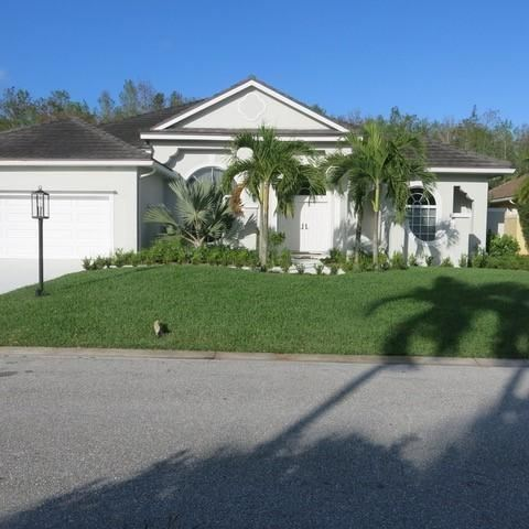 Photo of 20 Windward Isle(s), Palm Beach Gardens, FL 33418 (MLS # RX-10585994)