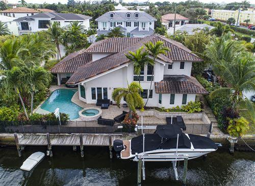 Photo of 661 NE Lakeview Terrace, Boca Raton, FL 33431 (MLS # RX-10587997)