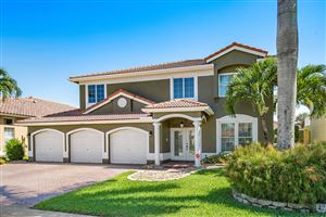 Photo of 10831 Tea Olive Lane, Boca Raton, FL 33498 (MLS # RX-10551998)