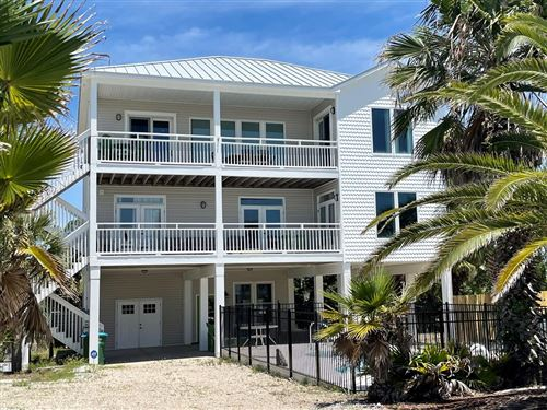 Photo of 1065 E GULF BEACH DR, Saint George Island, FL 32328 (MLS # 307026)