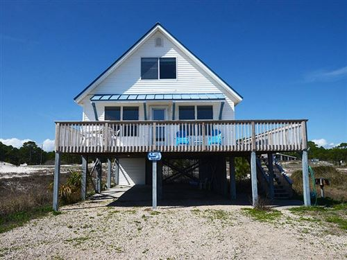 Photo of 1316 E GULF BEACH DR, Saint George Island, FL 32328 (MLS # 304051)