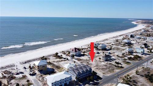 Photo of 102 S 26TH ST, Mexico Beach, FL 32456 (MLS # 306077)