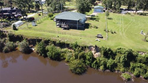 Photo of 1369 E RIVER RD, Wewahitchka, FL 32465 (MLS # 304093)