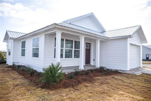 Photo of 111 OCEAN PLANTATION CIR, Mexico Beach, FL 32456 (MLS # 303110)