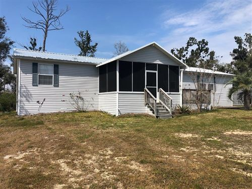 Photo of 247 SELMA ST, Port Saint Joe, FL 32456 (MLS # 304216)