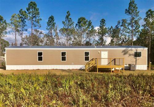 Photo of 269 SHADY GROVE LN, Port Saint Joe, FL 32456 (MLS # 305265)