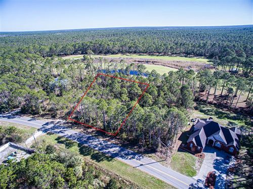 Photo of 12 COUNTRY CLUB RD, Port Saint Joe, FL 32456 (MLS # 305292)