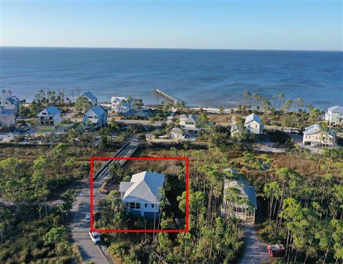 Photo of 217 SIGNAL LN, Port Saint Joe, FL 32456 (MLS # 306323)
