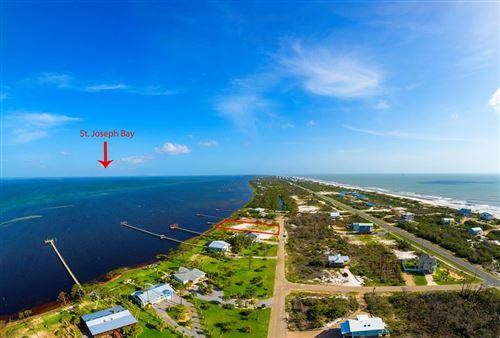 Photo of 7064 LEEWARD ST, Port Saint Joe, FL 32456 (MLS # 305599)