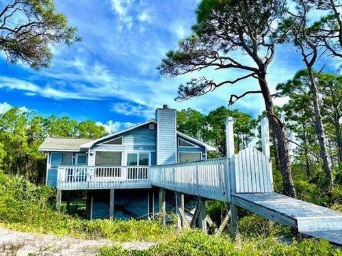Photo of 1365 E GULF BEACH DR, Saint George Island, FL 32328 (MLS # 305615)