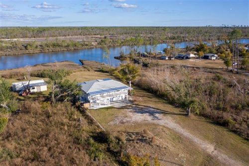 Photo of 178 CANAL DR, Overstreet, FL 32456 (MLS # 306638)
