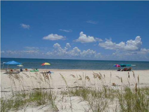 Photo of 1644 E GULF BEACH DR, Saint George Island, FL 32328 (MLS # 303649)