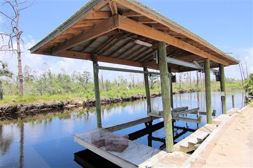 Photo of 209 WATER DR, Mexico Beach, FL 32456 (MLS # 304668)