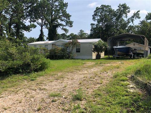 Photo of 118 CAROLINA ST, Carrabelle, FL 32322 (MLS # 308673)