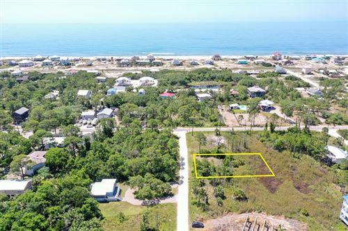 Photo of 304 BLEDSOE ST, Saint George Island, FL 32328 (MLS # 308680)