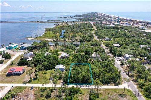 Photo of 305 BLEDSOE ST, Saint George Island, FL 32328 (MLS # 308681)