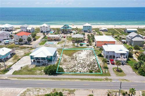 Photo of 1048 E GULF BEACH DR, Saint George Island, FL 32328 (MLS # 308688)