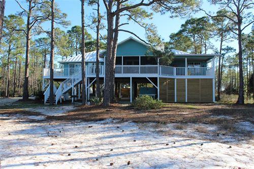 Photo of 1211 E GULF BEACH DR, Saint George Island, FL 32328 (MLS # 303717)