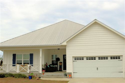Photo of 101 ST CHRISTOPHER ST, Mexico Beach, FL 32456 (MLS # 303966)
