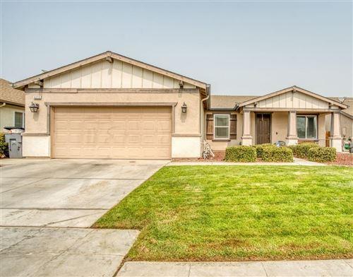 Photo of 5272 W Cotton Avenue, Fresno, CA 93722 (MLS # 548188)