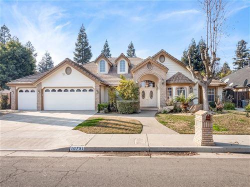 Photo of 10791 N Hampshire Drive, Fresno, CA 93730 (MLS # 555291)