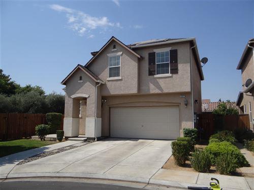 Photo of 4001 W Fig Tree Lane, Fresno, CA 93722 (MLS # 561473)